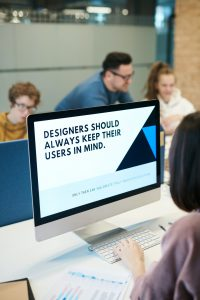 designer looking at design elements on screen