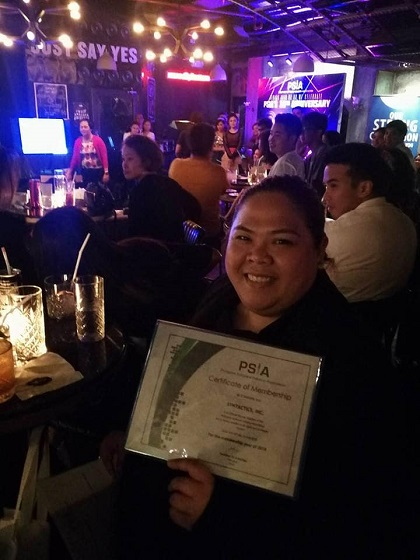 girl holding PSIA Certificate