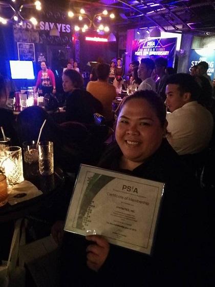 girl holding PSIA Certificate