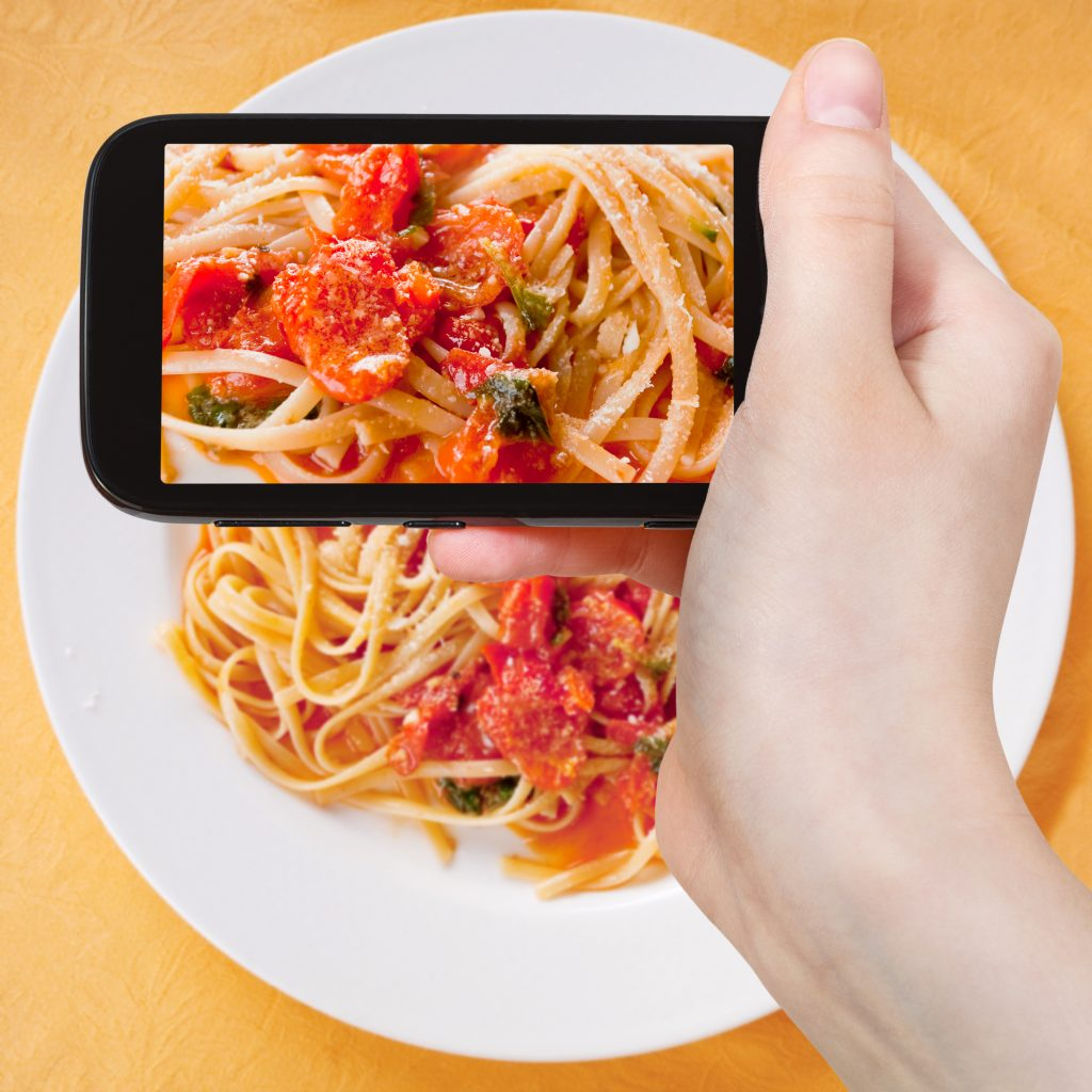 food blogger holding phone