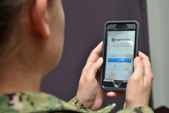 person from army holds phone that displays one example of the patient tracking systems