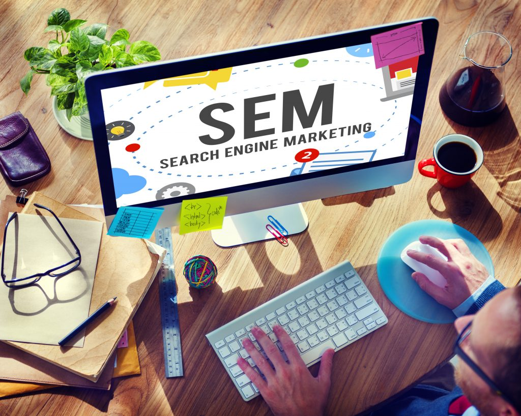 photo of monitor with text SEM SEARCH ENGINE MARKETING
