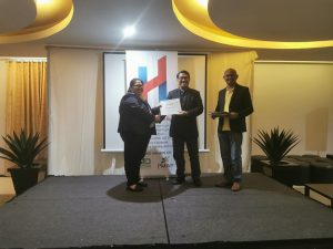Ms. Stephanie Caragos receiving her certificate on-stage