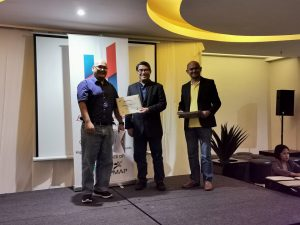 Mr Wilfredo Kaamiño receiving his DPO certificate on stage