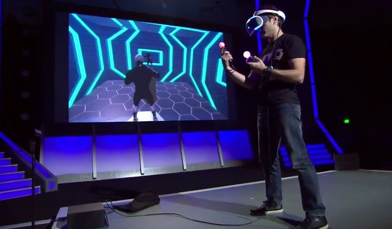 man using virtual reality gear with screen beside him as one of the most popular marketing trends