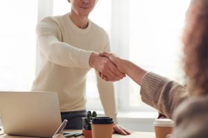 handshake between two people