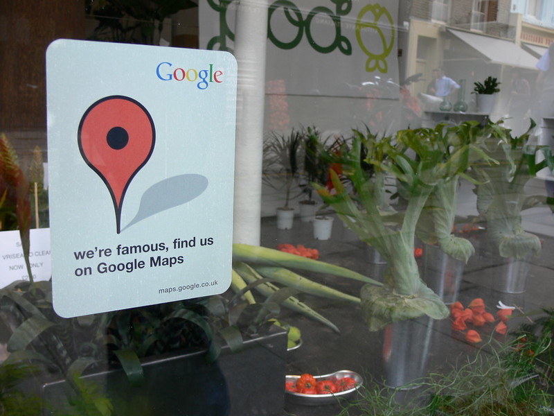 sign on physical shop that says they have a google maps business listing as a part of their marketing