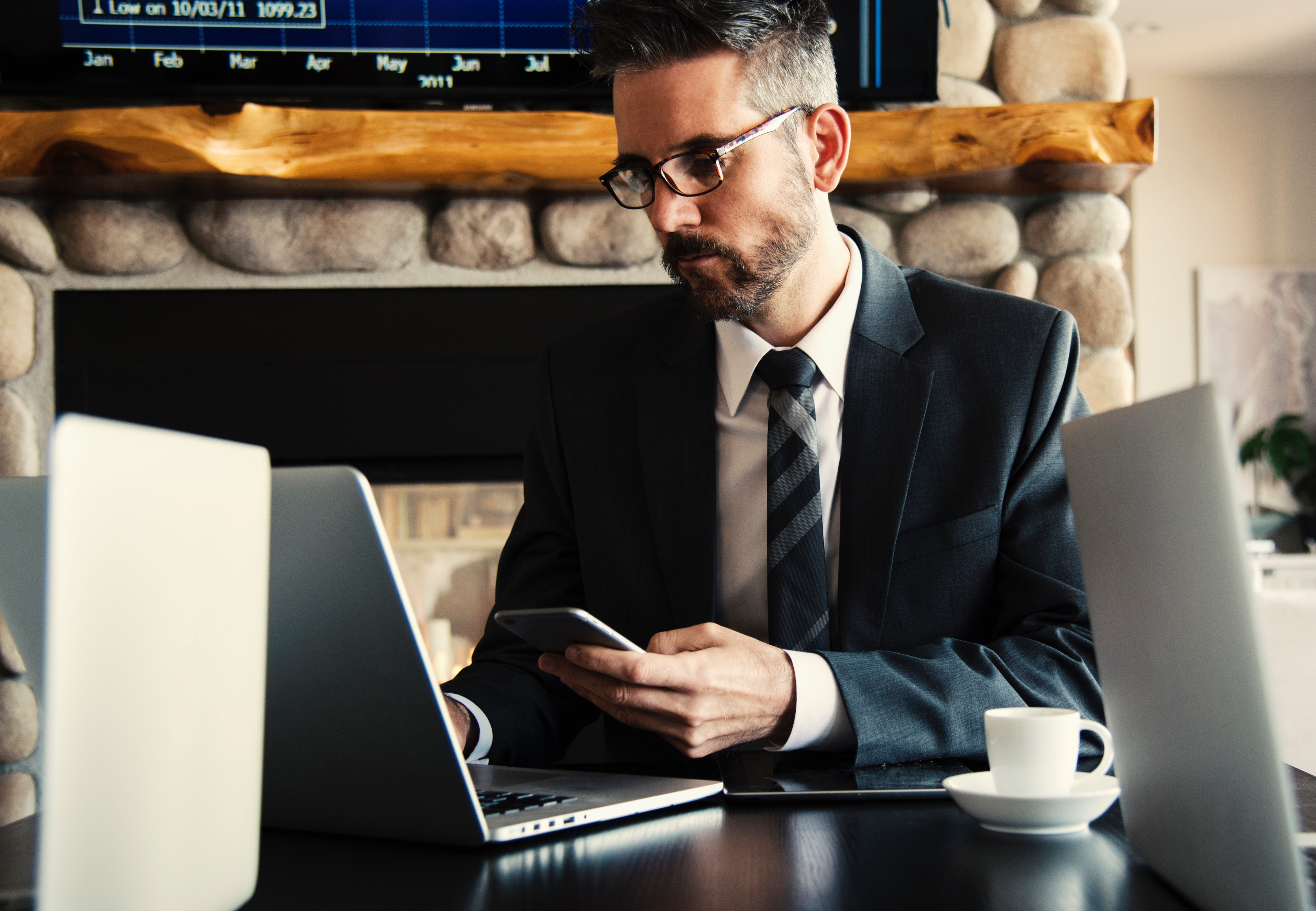 man in suit managing his business website
